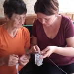 Pal Vilma teaching embroidery